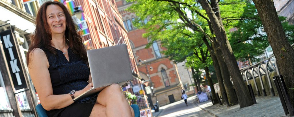 Davina White of business technology support firm OneTek launches the new GLEEfi ultrafast public WiFi service on Canal Street in Manchester.